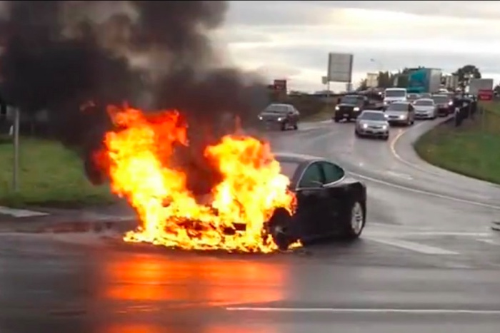 A Tesla Model S is on fire after a roadway collision