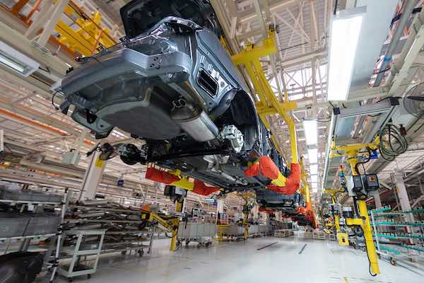 Car assembly line in a factory.