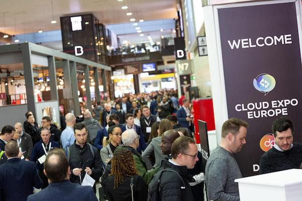 An image of attendees on the show floor at the Cloud Expo Europe trade show.
