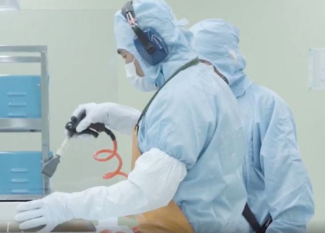 Employees at TSMC wearing protective gear.