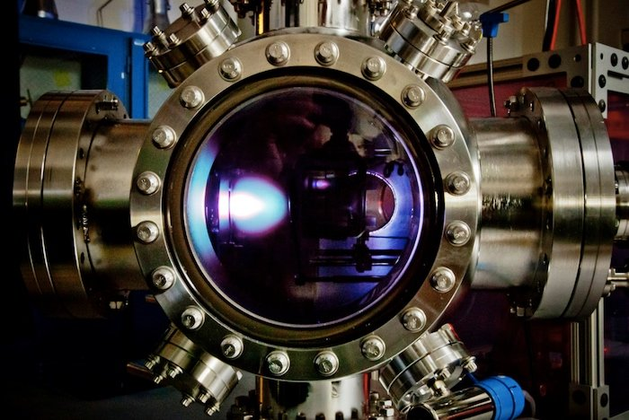 Ion beam deposition onto the thin film material.