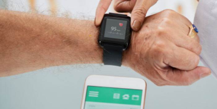 Patient using a smartwatch including Maxim's new optical sensor for biometric monitoring