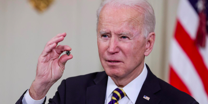 President Biden during the press conference holding a microchip