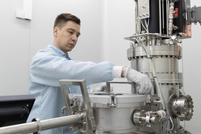 A scientist working on the Atomic Layer Deposition equipment.