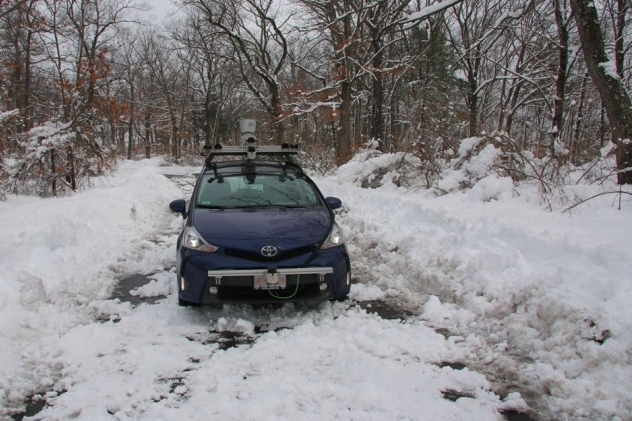 Self-driving vehicle totes GPR equipment through the snow to assess the ground conditions