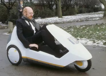 Sinclair demonstrating the C5 electric vehicle