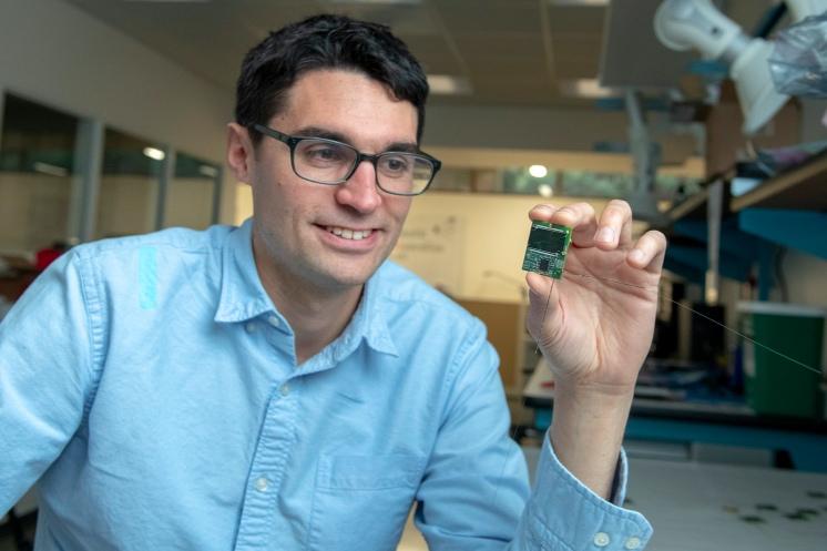 Zac Manchester holding a ChipSat