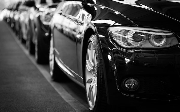 Cars parked next to each other in a black and white photo.