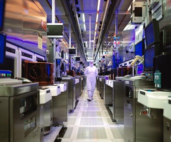 An employee walks through Intel Corporation's wafer fabrication facility in Chandler, Arizona.