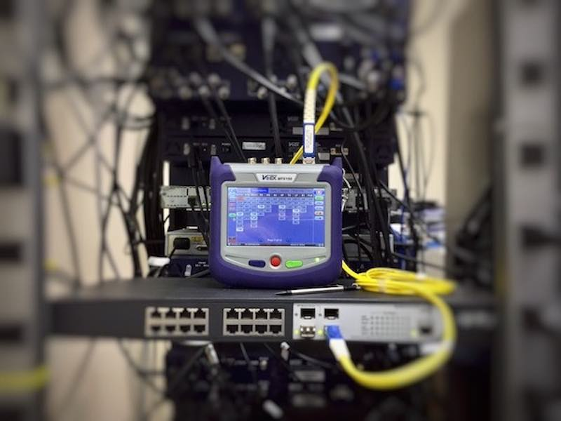 A telecommunication test connected to a network switch.