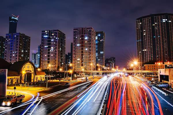 A time lapsed photo of a city road at night.